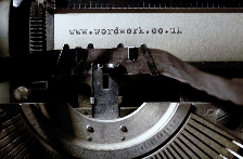 image shows wordwork name on an old typewriter